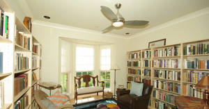 Photo - The previous owner of 6916 Cypress Hollow kept the large study in walls of books. Photo provided