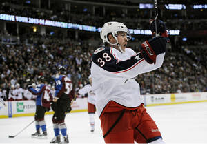 Photo - Columbus Blue Jackets center Boone Jenner celebrates a goal during the second period of an NHL hockey game against the Colorado Avalanche on Tuesday, Dec. 31, 2013, in Denver. (AP Photo/Chris Schneider)