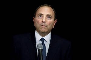 "Photo -   NHL Commissioner Gary Bettman faces journalists following collective bargaining talks in Toronto, Thursday, Oct. 18, 2012. Bettman received three counterproposals from the players' association on Thursday and left the negotiating table ""thoroughly disappointed,"" further shrinking the possibility of a full hockey regular season. (AP Photo/The Canadian Press, Chris Young)"