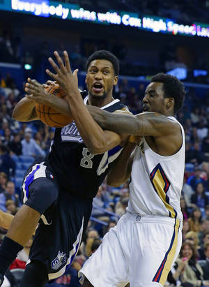Photo - Sacramento Kings small forward Rudy Gay (8) drives to the basket against New Orleans Pelicans small forward Al-Farouq Aminu in the first half of an NBA basketball game in New Orleans, Tuesday, Jan. 21, 2014. (AP Photo/Gerald Herbert)