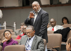 photo - Parent Larry Walker ask a question during a state Education Department community meeting at Metro Technology Center, Monday, December 10, 2012.   School officials outline their plan to help Douglass seniors graduate, and parents will have a chance to ask why 87 of 107 students there aren't on track to earn their diplomas. Photo By David McDaniel/The Oklahoman     Graduation