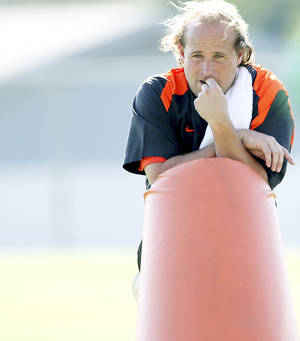Photo - Oklahoma State offensive coordinator Dana Holgorsen reportedly has interviewed for the head coaching job at Pittsburgh.  Photo by John Clanton, The Oklahoman