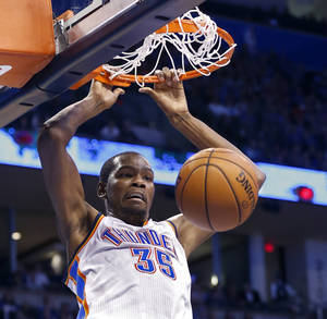 photo - Kevin Durant (35) scores as the Oklahoma City Thunder play the Portland Trail Blazers in NBA basketball at the Chesapeake Energy Arena in Oklahoma City, on Friday, Nov. 2, 2012.  Photo by Steve Sisney, The Oklahoman