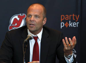 Photo - Norbert Teufelberger, chief executive of bwin.party digital entertainment, speaks at a news conference announcing a deal naming partypoker as the official online gaming partner of the Philadelphia 76ers, the New Jersey Devils and the Prudential Center, Thursday, Jan. 9, 2014, in Newark, N.J. (AP Photo/Adam Hunger)
