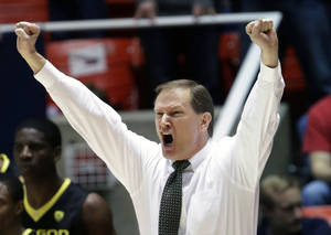 Photo - Oregon head coach Dana Altman shouts to his team in the first half during an NCAA college basketball game against Utah, Saturday, March 9, 2013, in Salt Lake City. Utah defeated Oregon 72-62. (AP Photo/Rick Bowmer) ORG XMIT: UTRB116