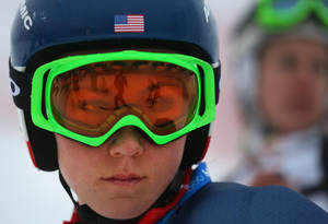 Photo - A skier is reflected in the goggles of United States' Mikaela Shiffrin as she stands on the alpine skiing training slopes at the Sochi 2014 Winter Olympics, Monday, Feb. 17, 2014, in Krasnaya Polyana, Russia. (AP Photo/Alessandro Trovati)