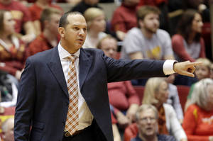 Photo - Auburn head coach Tony Barbee gestures to his team during the first half of an NCAA college basketball game against Iowa State, Monday, Dec. 2, 2013, in Ames, Iowa. Iowa State won 99-70. (AP Photo/Charlie Neibergall)
