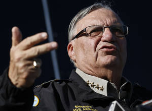 Photo - FILE-This Jan.9,2013 file photo shows Maricopa County Sheriff Joe Arpaio speaking with the media in Phoenix. Authorities say law officers in Arizona have intercepted an explosive device that was earmarked for Arpaio. (AP Photo/Ross D. Franklin,File)