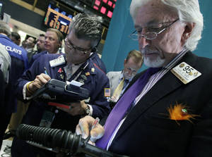Photo -   Traders John Panin, left, and Dan Tandy, right, work on the floor of the New York Stock Exchange Wednesday, Oct. 3, 2012.Stocks are mostly higher in early trading on Wall Street Wednesday after a measure of private sector hiring came in better than economists were expecting. (AP Photo/Richard Drew)