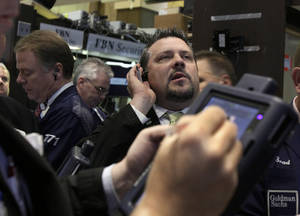 Photo - Trader Jason Harper, right, works on the floor of the New York Stock Exchange.  AP Photo