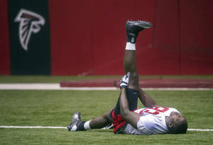 Photo - Atlanta Falcons Malliciah Goodman, from Clemson, warms up during NFL football rookie minicamp Saturday, May 4, 2013, in Flowery Branch, Ga. (AP Photo/John Amis)