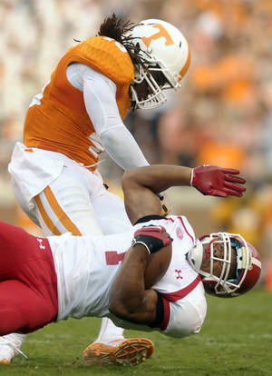 Photo - Tennessee linebacker A.J. Johnson (45) sends Austin Peay wide receiver Rashaan Coleman (1) to the ground during the first half of an NCAA college football game, Saturday, Aug. 31, 2013, in Knoxville, Tenn. (AP Photo/Knoxville News Sentinel)