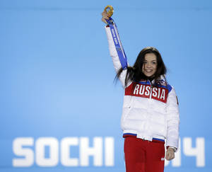 Photo - Women's free skate figure skating gold medalist Adelina Sotnikova of Russia celebrates during the medals ceremony at the 2014 Winter Olympics, Friday, Feb. 21, 2014, in Sochi, Russia. (AP Photo/David Goldman)