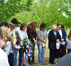 Photo - People gather in Grove for a remembrance service at the site of an old abortion clinic.  Photo provided by The Grove Sun
