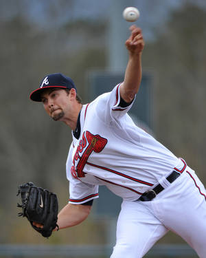 Photo - Atlanta Braves starting pitcher Mike Minor delivers during the first inning of an exhibition baseball game against the team's minor league Future Stars Saturday, March 29, 2014, in Rome, Ga. (AP Photo/David Tulis)