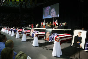 Photo - Casket sit in front of the stage of a memorial for firefighters who were killed in the West, Texas, fertilizer plant explosion prior to President Barack Obama's arrival, Thursday, April 25, 2013, at Baylor University in Waco,Texas. (AP Photo/Charles Dharapak)