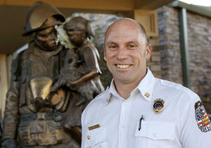 Photo - Jake Rhoades is the Edmond Fire Department's new fire chief. Photo by Jim Beckel, The Oklahoman