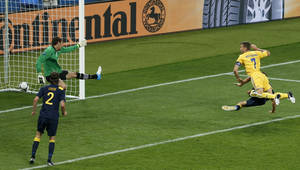 Photo -   Ukraine's Andriy Shevchenko, right, scores his side's first goal during the Euro 2012 soccer championship Group D match between Ukraine and Sweden in Kiev, Ukraine, Monday, June 11, 2012. (AP Photo/Darko Vojinovic)