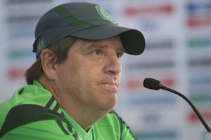 Photo - Mexico coach Miguel Herrera attends a press conference after running a training session in Mexico City, Wednesday, May 21, 2014. Mexico will play the World Cup in Brazil in Group A with Brazil, Croatia and Cameroon. (AP Photo/Christian Palma)