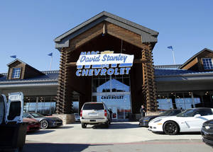 Photo - A David Stanley sign covers the Marc Heitz Chevrolet logo on the Norman dealership. <strong>STEVE SISNEY - THE OKLAHOMAN</strong>