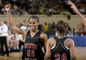Photo - Boynton-Moton's Breanna Hutchinson celebrates during finals of girl's Class B basketball state tournament  between Cyril and Boynton-Moton at the State Fair Arena, Saturday, March 6, 2010, in Oklahoma City. Photo by Sarah Phipps, The Oklahoman