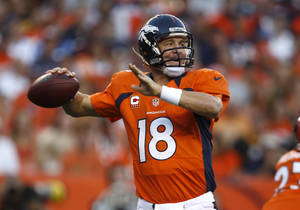 Photo -   Denver Broncos quarterback Peyton Manning looks to pass against the Pittsburgh Steelers during the first quarter of an NFL football game, Sunday, Sept. 9, 2012, in Denver. (AP Photo/David Zalubowski)