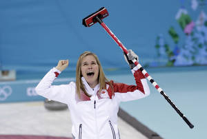Photo - Canada's skip Jennifer Jones celebrates after delivering the last rock to defeat Sweden in the women's curling gold medal game at the 2014 Winter Olympics, Thursday, Feb. 20, 2014, in Sochi, Russia. (AP Photo/Robert F. Bukaty)