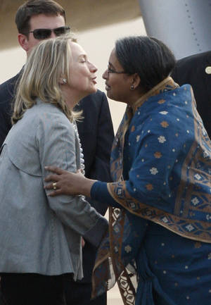 photo -   U.S. Secretary of State Hillary Rodham Clinton, left, is greeted by Bangladeshi Foreign Minister Dipu Moni upon her arrival in Dhaka, Bangladesh, Saturday, May 5, 2012. Clinton is in Bangladesh to press tolerance, democracy and development in one of the world's most impoverished nations that is now in the throes political turmoil. (AP Photo/Pavel Rahman)