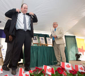 Photo - Former Montreal Expos third baseman Tim Wallach dons his Canadian Baseball Hall of Fame jacket during his induction to the Hall in St. Mary's, Ontario, Saturday, June 21, 2014. (AP Photo/The Canadian Press, Geoff Robins)