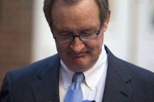 photo - Sen. Michael Crapo, R-Idaho looks down as he reads a statement outside Alexandria General District Court in Alexandria, Va., Friday, Jan. 4, 2013, after pleading guilty Friday to a misdemeanor first-offense drunken driving charge. In exchange for his plea Friday, prosecutors dropped a charge of failing to obey a traffic signal. Crapo received a $250 fine and a 12-month suspension of his driver's license and must complete an alcohol safety program.  (AP Photo/ Evan Vucci)
