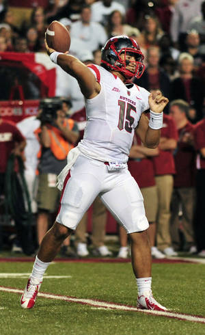 photo -   Rutgers quarterback Gary Nova passes during an NCAA college football game against Arkansas in Fayetteville, Ark., Saturday, Sept. 22, 2012. Rutgers defeated Arkansas 35-26. (AP Photo/April L. Brown)  