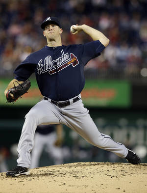 Photo - Atlanta Braves starter Alex Wood throws during the first inning of a baseball game against the Washington Nationals at Nationals Park Wednesday, Sept. 18, 2013, in Washington. (AP Photo/Alex Brandon)