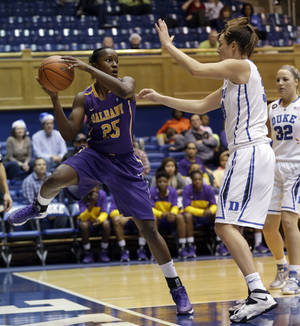 Photo - Albany's Shereesha Richards (25) looks to pass as Duke's Haley Peters defends at right during the second half of an NCAA college basketball game in Durham, N.C., Thursday, Dec. 19, 2013. Duke won 80-51. (AP Photo/Gerry Broome)
