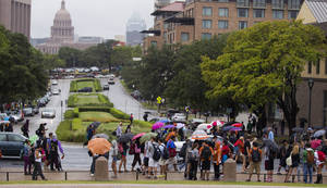 Photo -   University of Texas students stand outside after evacuating buildings at The University of Texas on Friday, Sept. 14, 2012 in Austin, Texas. Thousands of people streamed off university campuses in Texas and North Dakota on Friday after phoned-in bomb threats prompted evacuations and officials warned students and faculty to get away as quickly as possible. No bombs were found on either campus by early afternoon and it was not clear whether the threats were related. (AP Photo/Statesman.com, Ricardo B.Brazziell) MAGS OUT; NO SALES; INTERNET AND TV MUST CREDIT PHOTOGRAPHER AND STATESMAN.COM