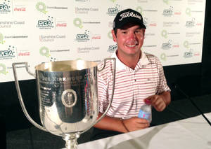 photo - Australian Daniel Popovic poses for a photo with the winner's cup after his victory at the Australian PGA in Coolum, Australia, Sunday, Dec. 16, 2012.  First-year tour player Popovic  took victory at the golf tournament, shooting a 3-under-par 69 on the final day for a four-stroke victory. (AP Photo/Denis Passa)