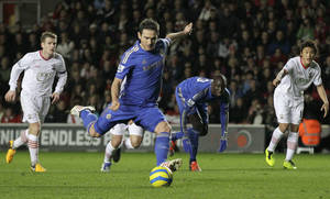Photo - Chelsea's Frank Lampard, center, scores a penalty against Southampton during their English FA Cup third round soccer match at St Mary's stadium, Southampton, England, Saturday, Jan. 5, 2013. (AP Photo/Sang Tan)