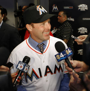 Photo -   New Miami Marlins manager Mike Redmond speaks with reporters after he was introduced at a baseball news conference in Miami, Friday, Nov 2, 2012. (AP Photo/Jeffrey Boan)