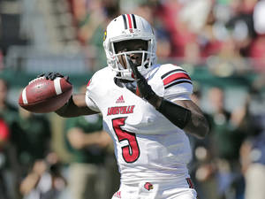 Photo - Louisville quarterback Teddy Bridgewater (5) looks for a receiver against South Florida during the first quarter of an NCAA college football game Saturday, Oct. 26, 2013, in Tampa, Fla. (AP Photo/Chris O'Meara)