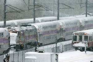 Photo - Massachusetts Bay Transportation Authority trains sit idle early Saturday, Feb. 9, 2013 in Boston due to high winds and the nearly two-feet of snow that fell in the area overnight. (AP Photo/Gene J. Puskar)