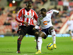 photo - Bolton Wanderers&#039; Marvin Sordell, roght, vies for the ball with Sunderland&#039;s  Titus Bramble, left, during their English FA Cup third round replay soccer match at the Stadium of Light, Sunderland, England, Tuesday, Jan. 15, 2013. (AP Photo/Scott Heppell)
