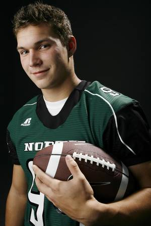photo - HIGH SCHOOL FOOTBALL: All State football player Bryce Easley, Norman North, in the OPUBCO studio, Wednesday, Dec. 17, 2008. BY NATE BILLINGS