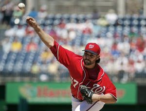 Photo - Washington Nationals pitcher Tanner Roark throws during the first inning of a baseball game against the San Diego Padres at Nationals Park Saturday, April 26, 2014, in Washington. (AP Photo/Alex Brandon)