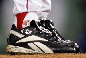 photo - FILE - In this Oct. 24, 2004, file photo, blood appears around the right ankle of Boston Red Sox pitcher Curt Schilling during the sixth inning of Game 2 of baseball's World Series against the St. Louis Cardinals in Boston. Schilling, whose video game company underwent a spectacular collapse into bankruptcy last year, is selling the blood-stained sock he wore during that game. (AP Photo/Winslow Townson, File)