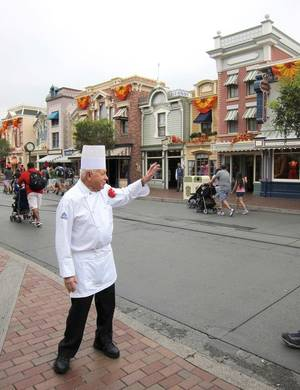 Photo - In this photo taken Sept. 20, 2013, Oscar Martinez, 77, greets diners at the Carnation Cafe at Disneyland in Anaheim, Calif. The chef is the park?s longest-tenured employee, beginning as a busboy nearly 57 years ago. He says he loves his job, and a new poll from the Associated Press-NORC Center for Public Affairs finds he?s not alone: Nine out of ten workers 50 and older say they?re satisfied with their work. (AP Photo/Matt Sedensky)
