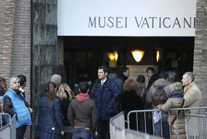 "photo - People queue to enter the Vatican Museums, at the Vatican Thursday, Jan. 3, 2013. It's ""cash only"" now for tourists at the Vatican wanting to pay for museum tickets, souvenirs and other services after Italy's central bank decided to block electronic payments, including credit cards, at the tiny city state. The Italian daily Corriere della Sera reported Thursday that Bank of Italy took the action because the Holy See has not yet fully complied with European Union safeguards against money laundering. That means Italian banks are not authorized to operate within the Vatican, which is in the process of improving its mechanisms to combat laundering. The Vatican says it's scrambling to find a non-Italian bank to provide the electronic payment services ""quite soon"" but declined to discuss Bank of Italy's concerns. The central bank had no immediate comment on the situation. (AP Photo/Alessandra Tarantino)"