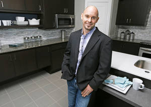 Photo - Jeff Click, owner of Jeff Click Homes, shows the kitchen of a model home at 17320 White Hawk Drive in the Silverhawk addition at NW 178 and Pennsylvania Avenue. Click, 37, is 2013 president of the Oklahoma State Home Builders Association.  Photos by NATE BILLINGS, The Oklahoman