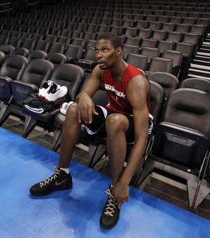 Photo - OKLAHOMA CITY THUNDER / MIAMI HEAT / NBA FINALS / NBA BASKETBALL: Miami Heat's Chris Bosh prepares to speak to reporters following practice before game two of the NBA basketball finals at the Chesapeake Energy Arena on Thursday, June 14, 2012 in Oklahoma City, Okla.  Photo by Steve Sisney, The Oklahoman