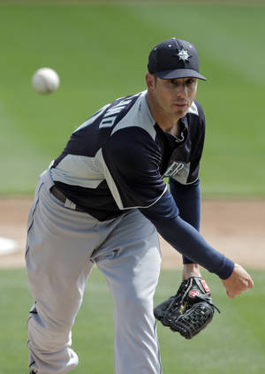 photo - Seattle Mariners starting pitcher Jon Garland delivers against the Los Angeles Dodgers in the first inning of an exhibition spring training baseball game on Saturday, March 9, 2013, in Glendale, Ariz. (AP Photo/Mark Duncan)