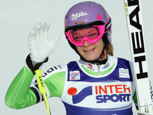 Photo - Germany's Maria Hoefl-Riesch celebrates her second place after completing an alpine ski, women's World Cup super-g,, in Cortina d'Ampezzo, Italy, Thursday, Jan. 23, 2014. (AP Photo/Armando Trovati)