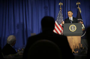 Photo - President Barack Obama speaks at the Business Council dinner in Washington, Wednesday, Feb. 27, 2013. (AP Photo/Pablo Martinez Monsivais)